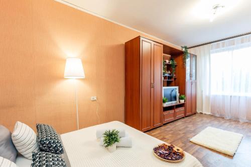 Кровать или кровати в номере Apartments Orehovyi Bulvar