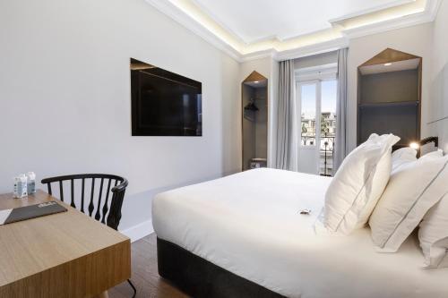 Cama o camas de una habitación en One Shot Recoletos 04