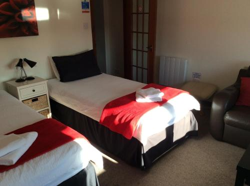 A bed or beds in a room at The Stag Hotel