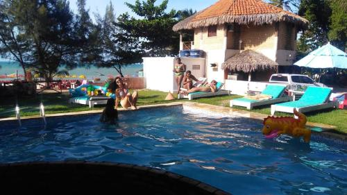 The swimming pool at or close to Pousada Blue Wind