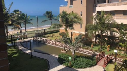 A view of the pool at Breezes do Cumbuco apartamento or nearby