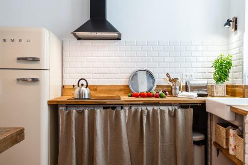 A kitchen or kitchenette at Au Vallon - doublon