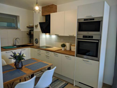 A kitchen or kitchenette at Romana Soul
