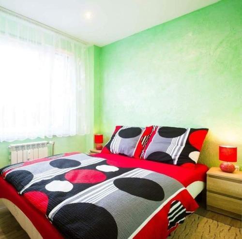 Łóżko lub łóżka w pokoju w obiekcie A&B Apartments
