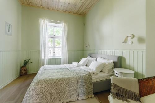 Ein Bett oder Betten in einem Zimmer der Unterkunft Villa Frieda