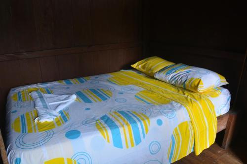 A bed or beds in a room at Posada El Esfuerzo