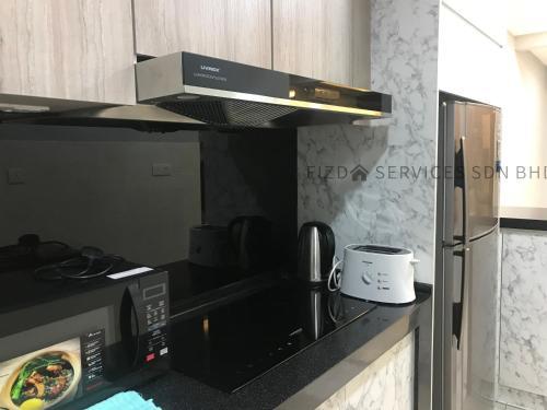 A kitchen or kitchenette at Cozy Apartment @ Hospital Sungai Buloh