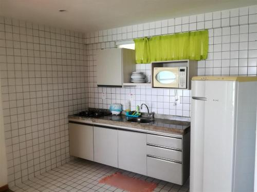 A kitchen or kitchenette at Apart Hotel Margherita