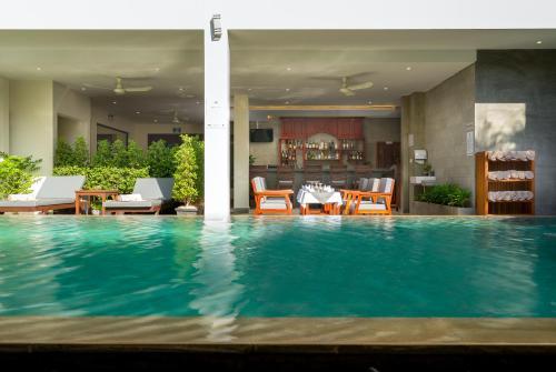 The swimming pool at or near Mony Reach Angkor Hotel