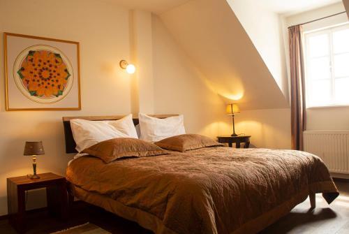 A bed or beds in a room at Babiččina Zahrada Penzion & Restaurant