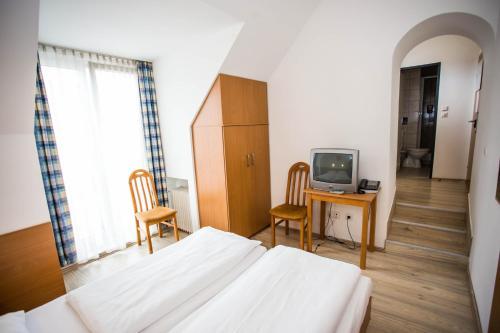 Un ou plusieurs lits dans un hébergement de l'établissement Hotel Geblergasse