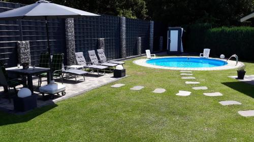 The swimming pool at or near FeWo Meyer mit Pool & Gartensauna