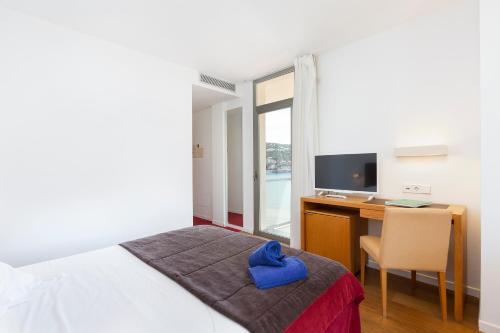 Letto o letti in una camera di Aimia Hotel