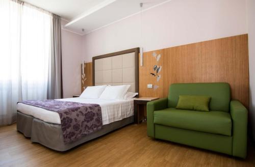 Кровать или кровати в номере Hotel Giolli Nazionale