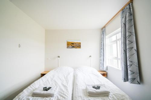 Un ou plusieurs lits dans un hébergement de l'établissement Skulagardur