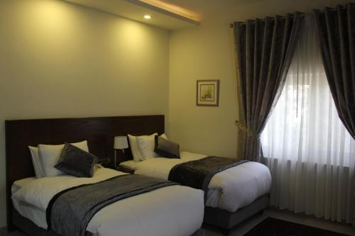 Кровать или кровати в номере Lavender Boutique Hotel