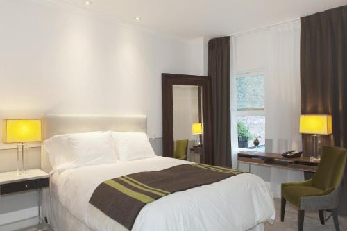 A bed or beds in a room at The Broome