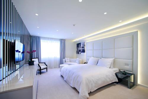 Een bed of bedden in een kamer bij Hotel 9