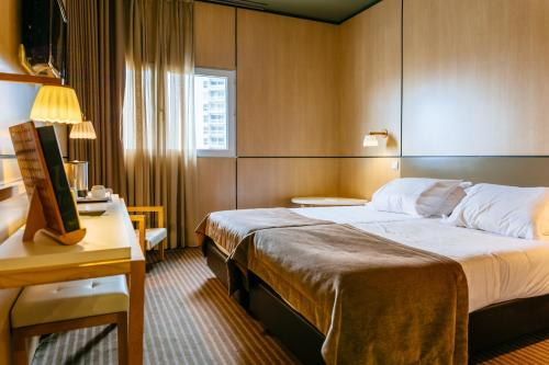 A bed or beds in a room at Axis Vermar Conference & Beach Hotel
