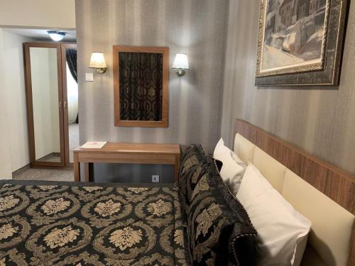 A bed or beds in a room at Bononia Hotel