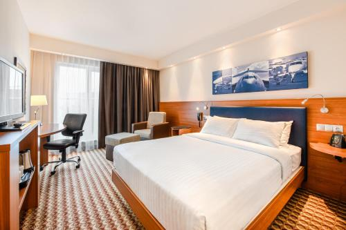 Letto o letti in una camera di Hampton by Hilton Warsaw Airport