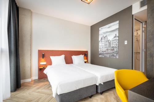 Een bed of bedden in een kamer bij Hotel New Kit