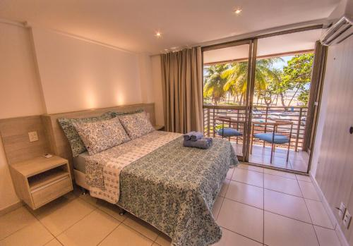 A bed or beds in a room at Luxor Cabo Branco Home Service