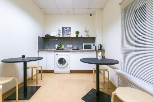 A kitchen or kitchenette at Taiga Nsk