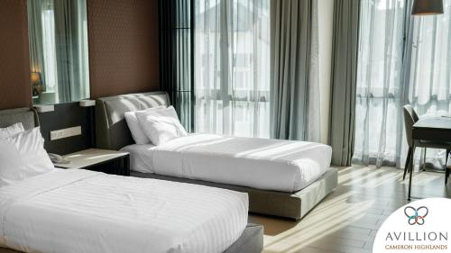 A bed or beds in a room at Avillion Cameron Highlands