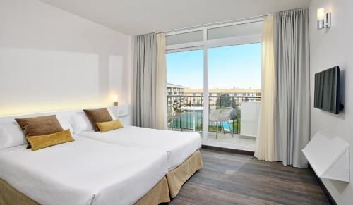 Säng eller sängar i ett rum på Sol Principe
