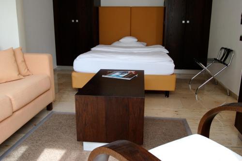 Кровать или кровати в номере BURNS Apartments