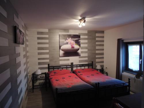 Ein Bett oder Betten in einem Zimmer der Unterkunft Hotel de la Gare