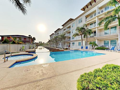 The swimming pool at or near New Listing! Modern Beach Condo With Infinity Pool Condo
