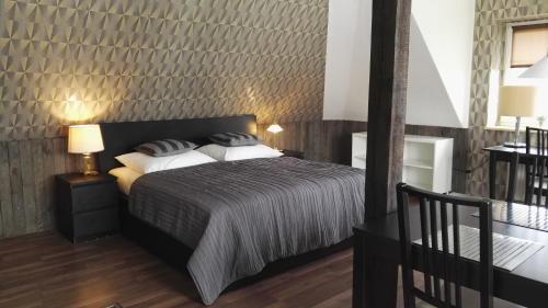 Łóżko lub łóżka w pokoju w obiekcie Kaszubiana direkt in der Natur