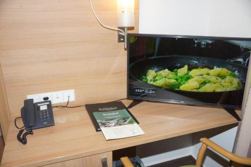 A television and/or entertainment center at Hotel Krauthof