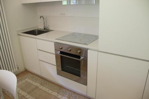 A kitchen or kitchenette at La Tana delle Marmotte
