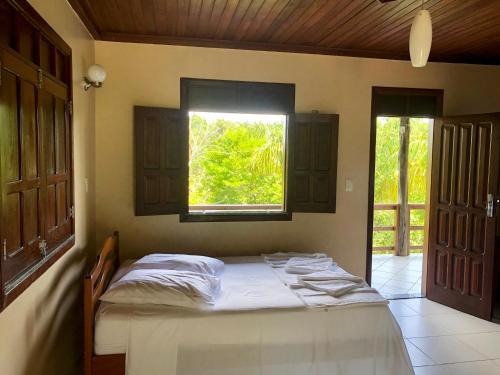 Cama ou camas em um quarto em Amazônia ParkSuítes