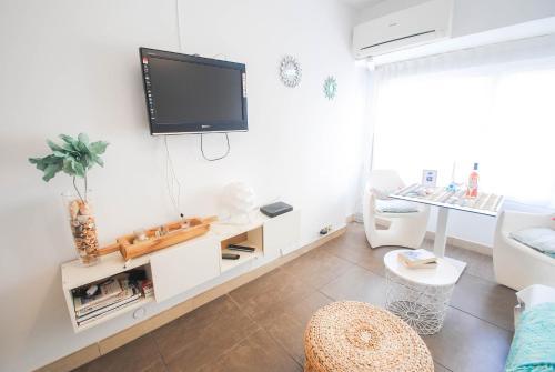 En tv och/eller ett underhållningssystem på Malaga Center Flat Exclusive