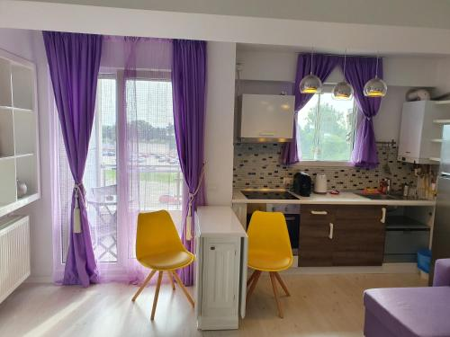 A kitchen or kitchenette at Airport Residence