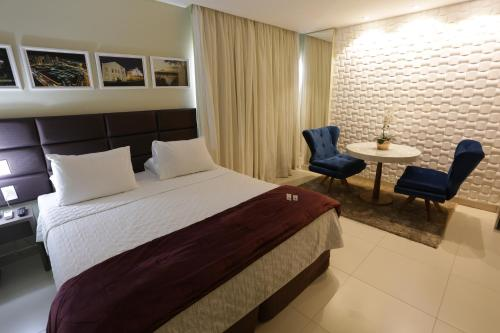 A bed or beds in a room at Uchôa Teresina Hotel