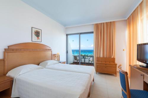 Ein Bett oder Betten in einem Zimmer der Unterkunft Blue Horizon