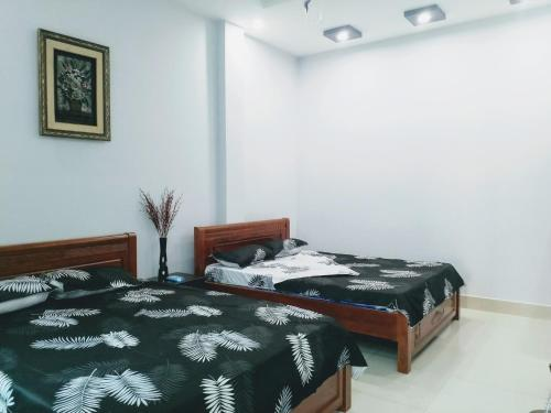 A bed or beds in a room at Homestay Sofie