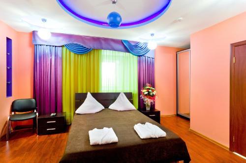 Кровать или кровати в номере Зарайск ТГК