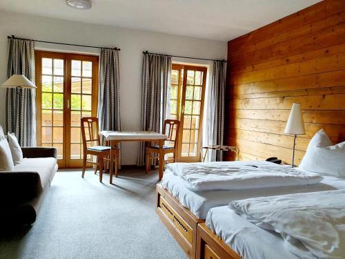 """Ein Bett oder Betten in einem Zimmer der Unterkunft Landgasthof """"Wilder Mann"""""""