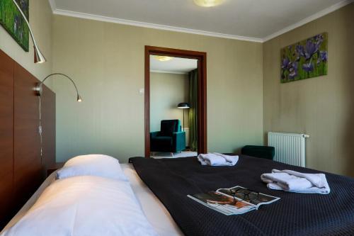 Un ou plusieurs lits dans un hébergement de l'établissement Zielony Ogród