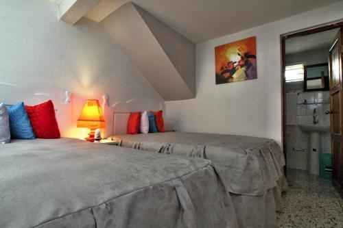 A bed or beds in a room at Villa Juanita