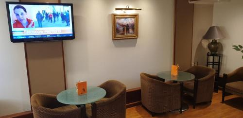A television and/or entertainment center at Castelli Hotel Nicosia