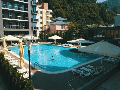 The swimming pool at or near Hotel Neptun