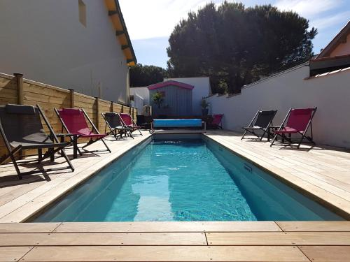 The swimming pool at or near Hôtel Le Nautile