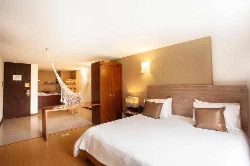 A bed or beds in a room at Viaggio Urbano Business